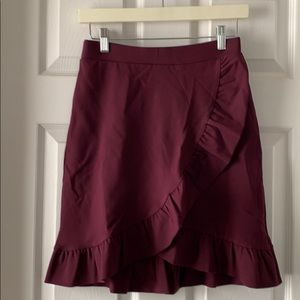 Adorable plum ruffle wrap skirt from the LOFT